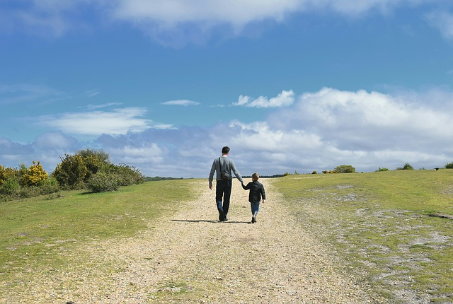 Father walking with son holding hands