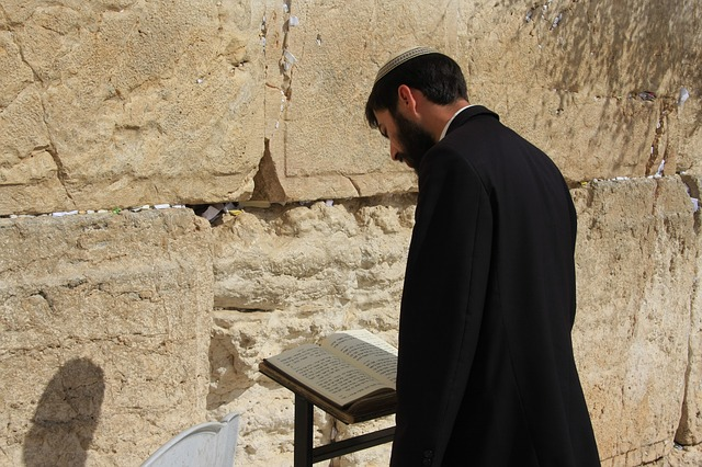 Jewish man praying at the wailing wall