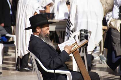 jewish man reading masoretic text with annotations